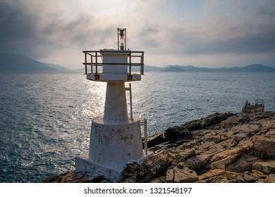 Lighthouse during sunset. Mount Johnson Lighthouse from Ap Lei Pei, Hong Kong.
