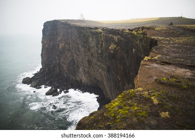 Lighthouse in Dyrholaey promontory on the southern coast of Iceland in rainy day