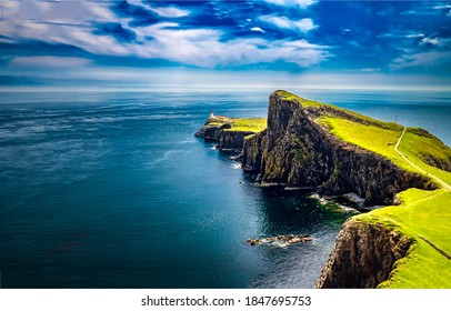 Lighthouse at edge of sea cliff. Sea  coastal cliff landscape. Coastal cliss view
