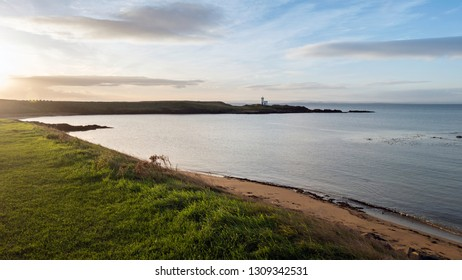 The Lighthouse, Elie Ness and Wood Haven Beach, from the Fife Coastal Path at Ruby Bay, Elie, Fife, Scotland.