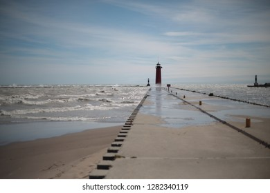 Lighthouse at end of harbor wall during storm in Kenosha Wisconsin