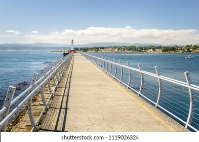 Lighthouse at the End of Ogden Poit Breakwater in Victoria, BC, Canada, ona Clear Summer Day