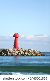a lighthouse floating alone on the blue sea