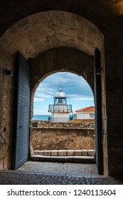 Lighthouse of the fortified city of Peniscola in the Costa del Azahar in Castellon on a rainy day, Valencian Community in Spain.
