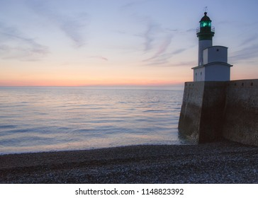 Lighthouse in front of the Manche sea in the city of Le Tréport in Normandy, France.