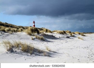 lighthouse in front of a thunderstorm / Sylt Germany