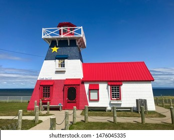 Lighthouse in Grande Anse in northern New Brunswick Canada in the colors of the Acadian Flag overlooking the Bay of Chaleur.