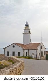 Lighthouse in harbor Cala Ratjada, Majorca, Spain