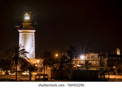 The Lighthouse in the Harbor of Malaga, Spain, at Night