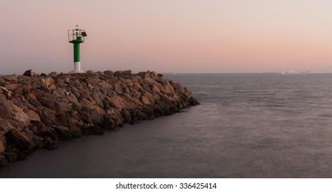 Lighthouse in the harbor of Port Sa Playa , Alboraya , Valencia, Spain