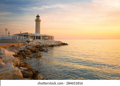 Lighthouse in the harbour of Patras, Peloponnese, Greece.