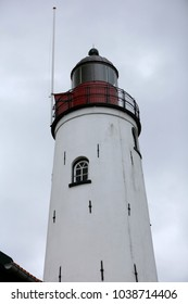 Lighthouse in a harbour at the sea