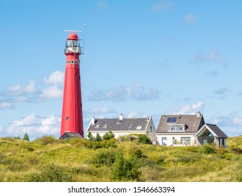 Lighthouse and houses in dunes of Schiermonnikoog, West-Frisian island in Waddensea, Netherlands