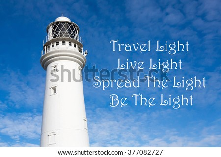 Lighthouse Inspirational Motivational Quote Travel Light Stock Photo