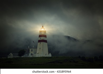 Lighthouse Light Night, Fishing Village In Godoya Island - Giske, Romsdal county, Norway.