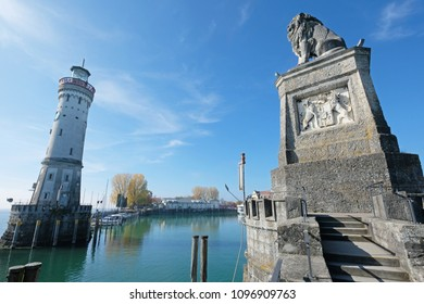 Lighthouse and a lion statue at the entrance to the harbor of Lindau, Germany, Europe