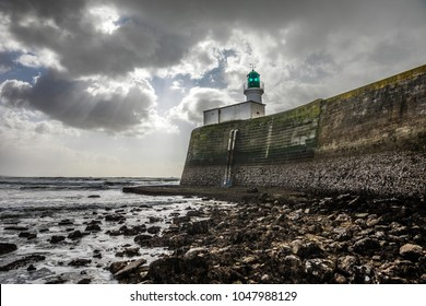 Lighthouse of the little jetty of les Sables d'Olonne at low tide