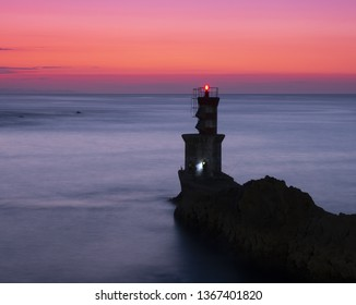 lighthouse for maritime navigation at sunset, Basque country