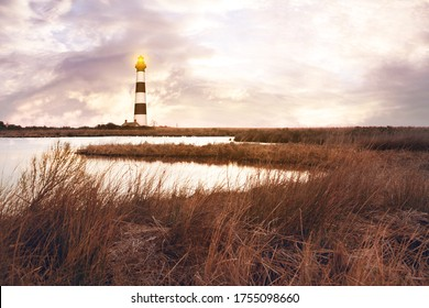 The lighthouse with marshlands soft blurry background.