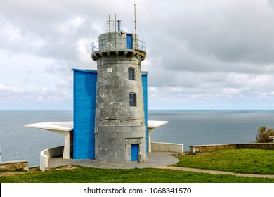 lighthouse at Matxitxako, Cape Bermeo, Vizcaya, Basque Country, Spain. bird watcher