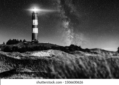 Lighthouse with milky way at night. dunes of Amrum
