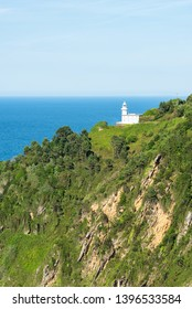 The lighthouse of Monte Igeldo in its environment in San Sebastian. Vertical framing. Basque Country of Spain.