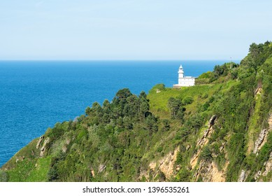 The lighthouse of Monte Igeldo in its environment. San Sebastian, Basque Country of Spain.
