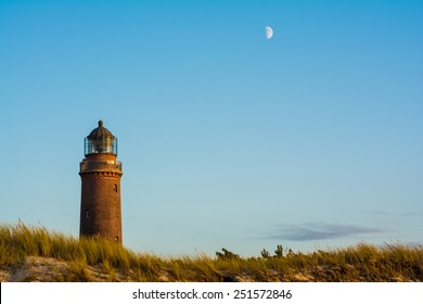 lighthouse and moon at Darss Peninsula in Germany