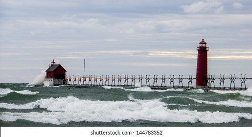 Lighthouse near Grand Haven, MI being pounded by high waves