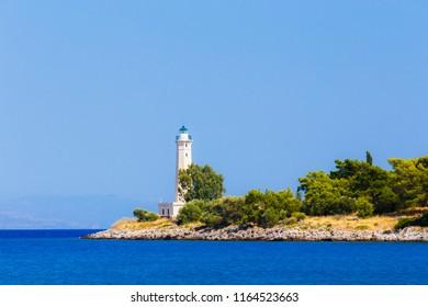 Lighthouse near Gythio in the afternoon against a blue sky