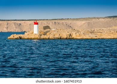 Lighthouse near the Krk bridge on the east side of the island Krk, Croatia