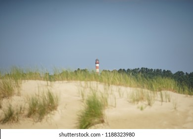 Lighthouse in Nida, Lithuania. The Nida lighthouse is located in Nida. shot on a long-range lens from dunes