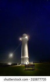 lighthouse at night by moonscape