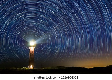 Lighthouse at night with star trails at the center at Ouddorp, the Netherlands