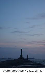 Lighthouse at night in Xi Zi Wan bay, Kaohsiung, Taiwan