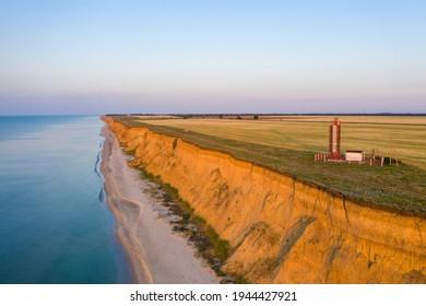 Lighthouse on the Black Sea coast. Beautiful steep coast. Kurortne, Odessa Oblast, Ukraine