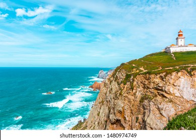 The lighthouse on the cliff in Cabo da Roca (Cape Roca) the westernmost  extent of mainland Portugal, continental Europe and the Eurasian land mass. Bright vivid panoramic landscape.