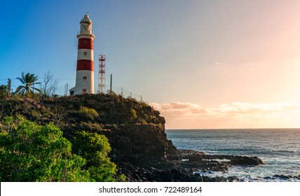 lighthouse on a cliff during sunset in albion, mauritius