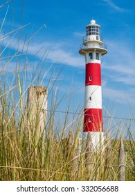 Lighthouse on the coast of the North Sea in a sunny day, Belgium