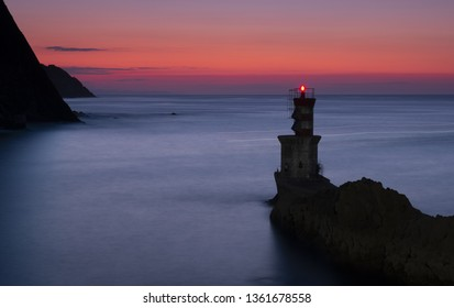 lighthouse on the coast at sunset in Pasaia, Basque Country