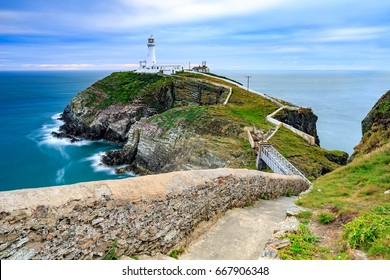 Lighthouse on coastal island with horizon at South Stack in Holyhead, North Wales.