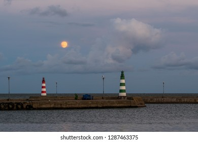 Lighthouse on the Curonian Spit in Nida. Night seascape in Nida with moonlight.