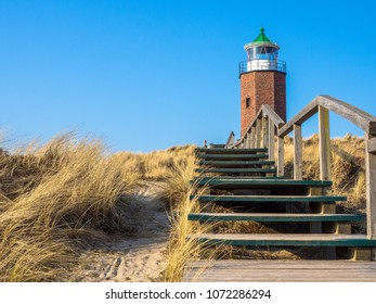 Lighthouse on dune against blue sky in Wenningstedt on the Island Sylt in Germany
