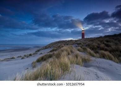 lighthouse on dune in dusk, Texel, Holland