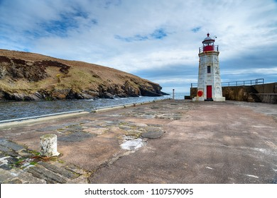 The lighthouse on the harbour at Lybster in Caithness on the east coast of Scotland