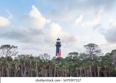 Lighthouse on Hunting Island Beach at Hunting Island State Park in Beaufort, South Carolina.