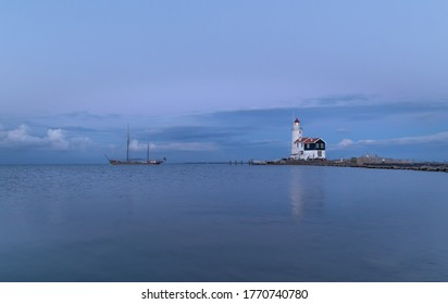 The lighthouse on the island of Marken in The Netherlands. Marken is a small fishing village near Amsterdam.