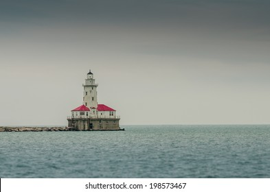 The lighthouse on Lake Michigan provides a reminder that the calm waters can be dangerous for ships