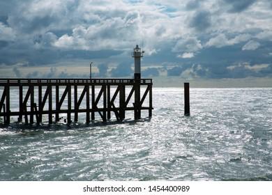 Lighthouse on a pier in Blankenberge, Flanders, Atlantic coast, Belgium
