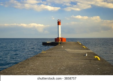 Lighthouse on pier by lake Ontario